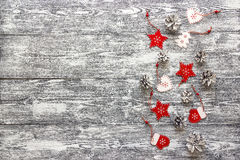 Background with a border of red Christmas decorations and white Royalty Free Stock Images