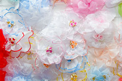 Background of the bows for the hair. Many bows on the bench in the shop royalty free stock photography