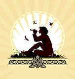 Background with boy playing on panpipe Stock Photo