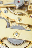 Background from brass clockwork of retro clock Royalty Free Stock Photo