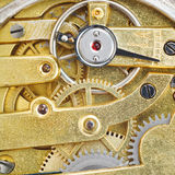 Background from brass gear movement of retro watch Stock Images