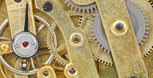 Background from brass mechanical clock movement Royalty Free Stock Photo