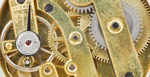 Background from brass mechanical clockwork Stock Photography
