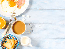 Background breakfast fried eggs, coffee and toast. Top view royalty free stock photography