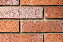 Background of a brick from close distance. Structure and structure of a building brick from close distance Stock Photos