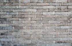 background brick grey wall Στοκ Φωτογραφίες