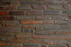 Background brick wall. Brown clinker stone background of a house showing a brick wall Royalty Free Stock Photo