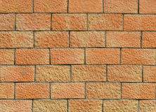 Background of a brick wall. Background of terracotta brick wall Stock Photo