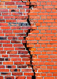 Background brick wall with crack Stock Photos