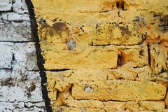 Brick wall painted in different colors Stock Photo