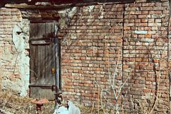 Background brick wall and old wooden door.  Royalty Free Stock Image