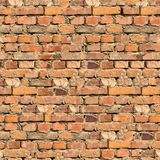 Background of Brick Wall Texture. Cracked Brown Brick Wall Texture. Grunge Seamless Tileable Texture Royalty Free Stock Image