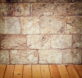 Background of brick wall texture from jerusalem stone with wooden floor Royalty Free Stock Photography