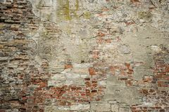 Background of brick wall torn apart by time. Old wall of different texture royalty free stock images