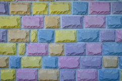 Background   bricks in many different colours. Stock Photography