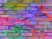 Background bricks wall. Pink, blue and other vibrant colors. Background bricks wall. Stains and Blots. Pink, blue and other vibrant colors Royalty Free Stock Photo