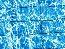 Background of bright blue clear water in the pool. Riple. Blue. Wet stock photo