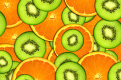 Background bright fruit, oranges and kiwi stock photos