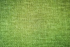 Background of bright green cloth fibers and empty space for text.  royalty free stock photography