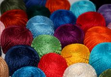 Background of many small balls of colored bright threads Stock Photos