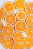 Background of  bright orange slices Stock Photo