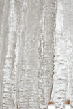 Background of bright transparent hanging down icicles. Ice textu Stock Images