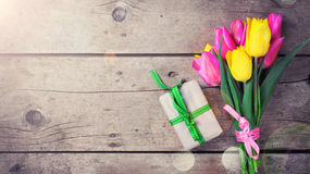 Background with bright yellow and pink spring tulips flowers and Royalty Free Stock Photo
