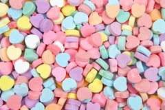 Background of brightly colored candy hearts for Valentine`s Day. Popular candy for this annual holiday stock image