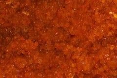 Background - red salmon caviar. Background - brightly red salted salmon caviar closeup stock photos