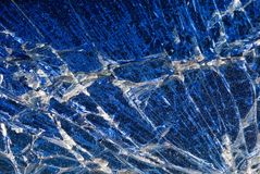 Background - Broken Blue Glass Abstract. Broken windshield macro Royalty Free Stock Images
