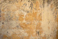 Background broken dirty old wall of painted glossy plaster.Blan Stock Image