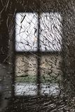 Background of broken transparent window glass. Close-up royalty free stock photo