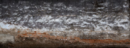 Background broken wall with dirty plaster and old brick. Stock Photos
