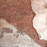Background broken wall with dirty plaster and old brick. Stock Photo