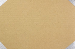 Background of brown cardboard with duct taped edge Royalty Free Stock Images