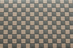 Background brown checkerboard pattern. Old brown leather background by checkerboard pattern Royalty Free Stock Photos