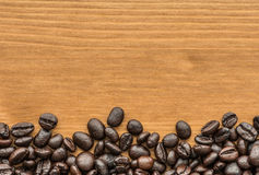 Background of brown coffee beans on wood board Royalty Free Stock Photo