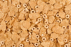 Background of brown oat cereals top view. Top view background texture of pile of oat brown breakfast cereals Royalty Free Stock Photography