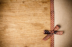 Background with brown ribbon and kraft paper Royalty Free Stock Image