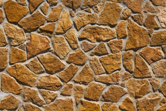 Background of brown stones. Wall made of large yellow stones Royalty Free Stock Image