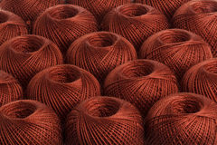 Background brown yarn. Texture of colored yarn skeins royalty free stock photos