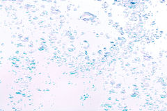 Background of bubbles in the water in blue and violet tones Stock Photography