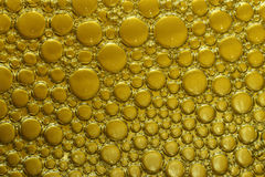 Background of bubbles in yellow Stock Images