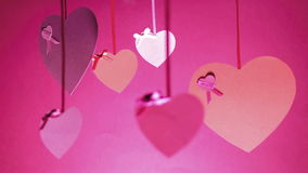 Background Bunch of Valentines Valentine`s Day. Valentine`s Day Bunch Of Hearts Swinging Pink colour stock footage