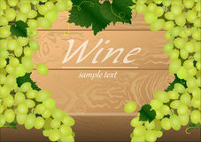 Background with bunches of green grapes on a wooden table Royalty Free Stock Images