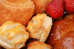 Background from buns and strawberry Stock Images