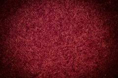 Background burgundy walls of the threads. Stock Photo