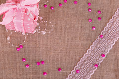 Background of burlap with pink git box Stock Images