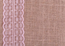 Background of burlap with pink lace Royalty Free Stock Photos