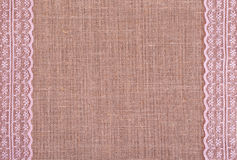 Background of burlap with pink laces Royalty Free Stock Photos